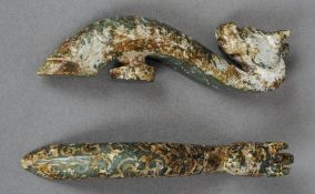 Two Chinese jade belt hooks Each formed as a dragons head.  Each 11.5 cm high.  (2) CONDITION
