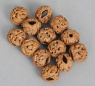 A quantity of 19th century Chinese carved beads Each formed from small nut, decorated with figures
