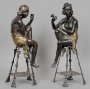 A pair of Art Deco style bronze figurine