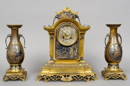 A 19th century gilt bronze clock garniture