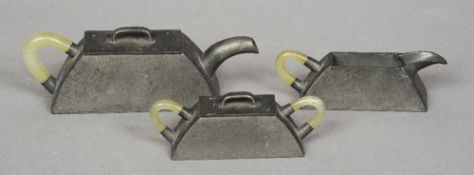 An early 20th century jade handled pewter tea set Comprising: teapot, lidded sugar bowl and milk