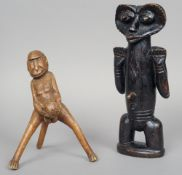 Two African tribal carved wooden fertility figures Each of unusual form.  The largest 31 cm