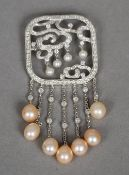 An 18 ct white gold, diamond and pearl set pendant