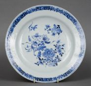An 18th century Chinese blue and white porcelain plate The rim with floral and Greek key pattern