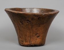 A large early carved hardwood mortar Of flared cylindrical form.  25 cm high. CONDITION REPORTS: