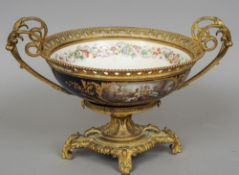 A 19th century gilt bronze mounted Sevres style porcelain tazza The main body with hand painted