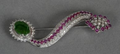 An unmarked white gold, diamond, ruby and jade set brooch
