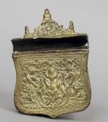 An antique Balkans brass cartridge case The shield shaped body with embossed decoration, the