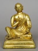 A fine quality antique gilt bronze model of Buddha Modelled seated, the base with calligraphy to
