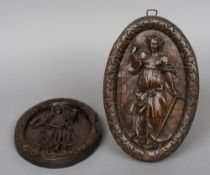 A pair of 18th century carved oak panels One carved with Faith, the other Charity.  25.5 cms