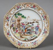 An 18th century Chinese famille rose plate The octagonal border with vignettes of birds amongst