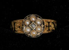 An 18 ct gold enamel decorated diamond and seed pearl set memorial ring Centred with a small diamond