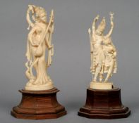 A pair of Indian ivory figures Each carved as a deity, standing on a carved stepped wooden plinth