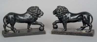 A pair of 19th century cast iron lion form door stops Each naturalistically modelled with one