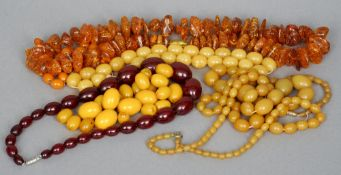 A quantity of amber type bead necklaces and loose beads