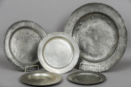 Five pewter dishes The largest with maker's mark for Robert Nicholson and London touch mark, another