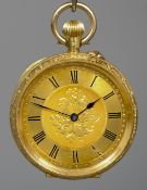A lady's 18 ct gold cased pocket watch The dial with Roman numerals, the engraved case marked 18K
