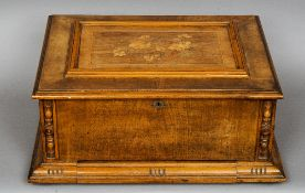 A late 19th century marquetry inlaid walnut cased Stella disc music box The hinged florally inlaid