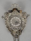 A 19th century Dutch silver miniature wall clock The domed top with a pierced crest flanked by