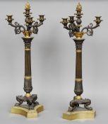 Manner of THOMAS HOPE (1769-1831) British A pair of 19th century ormolu mounted bronze candelabra