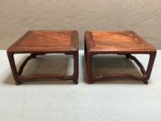 A pair of carved Chinese urn stands, possibly haung hua li wood 8.5 cm high.  (2) CONDITION REPORTS: