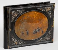 A 19th century Oriental tortoiseshell folio cover Of hinged form, the front decorated with a panel