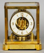 A LeCoultre brass cased Atmos clock Of typical form, the front with an inscribed presentation