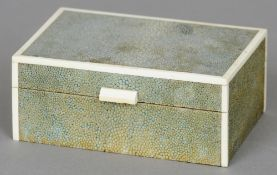 An Art Deco ivory mounted shagreen cigarette box Of hinged rectangular form with ivory bandings