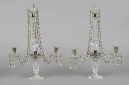 A pair of Victorian clear glass table lustres The prismatic columns issuing faceted drops above