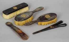 A late 19th/early 20th century gold inlaid tortoiseshell backed dressing table set Comprising: three