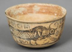 An Indus Valley antiquity bowl The exterior decorated with cows.   9 cm diameter. CONDITION REPORTS: