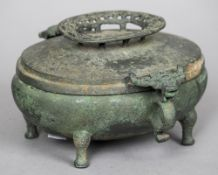 A Chinese patinated bronze censer, possibly Warring States Period Of oval form, with twin mythical