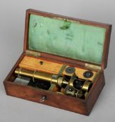 A Victorian brass monocular microscope, inscribed Georges Oberhaeuser Place Dauphine 19 Paris Housed