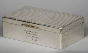 A large silver cigarette box, hallmarked Sheffield 1927, maker's mark of Walker & Hall Of