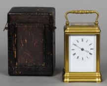 A 19th century French gilt brass cased striking carriage clock The white enamel dial with Roman
