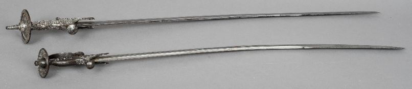 Two Indo-Persian tulwars Each handle with silvered decoration. The largest 92 cm long. (2) CONDITION