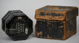 A cased C. Wheatstone & Co. concertina, numbered 26701 Housed in a fitted leather case.  20 cm wide.