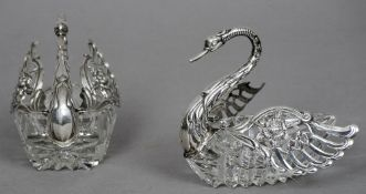 A pair of silver mounted cut glass table salts Modelled as swans, both stamped 925 and with London