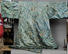 A late 19th century Chinese silk robe The blue ground decorated with butterflies and floral sprays.