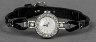 A lady's platinum, diamond set cocktail watch  CONDITION REPORTS: Overall good, some general wear.