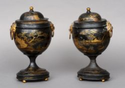 A pair of 19th century Dutch tole ware chestnut urns and covers Each with gilt chinoiserie