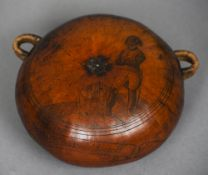 A 19th century carved gourd flask With twin loop handles, one side decorated with a flower, the