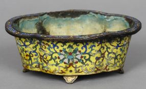 A 19th century Chinese cloisonne bowl Of lobed form, decorated in the round with floral scrollwork.