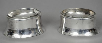 A pair of 17th century English silver trencher salts, marks indistinct Of typical form.  4 cm high.