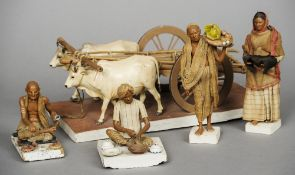 Four various Indian terracotta punah figures, together with an oxen and cart group The latter 27.5