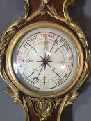 A 19th century French ormolu mounted kingwood barometer 116 cm high. CONDITION REPORTS: Some gilt