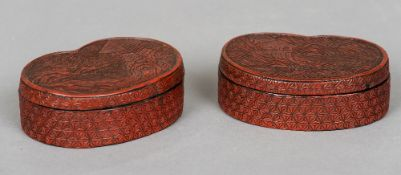 Two Chinese cinnabar lacquered boxes Each of rounded heart shape, each decorated with a coastal