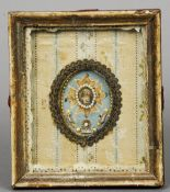 An 18th/19th century French reliquary panel  Framed and glaze, the frame with wax seal marks.  15 cm