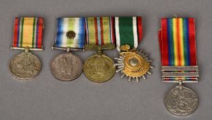 A group of three medals Comprising: Falklands Campaign South Atlantic medal with rosette, Suez Canal
