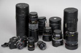 A small quantity of camera equipment Including: a Leica Leitz Super Elmar-R 1:3.5/15 lens, three